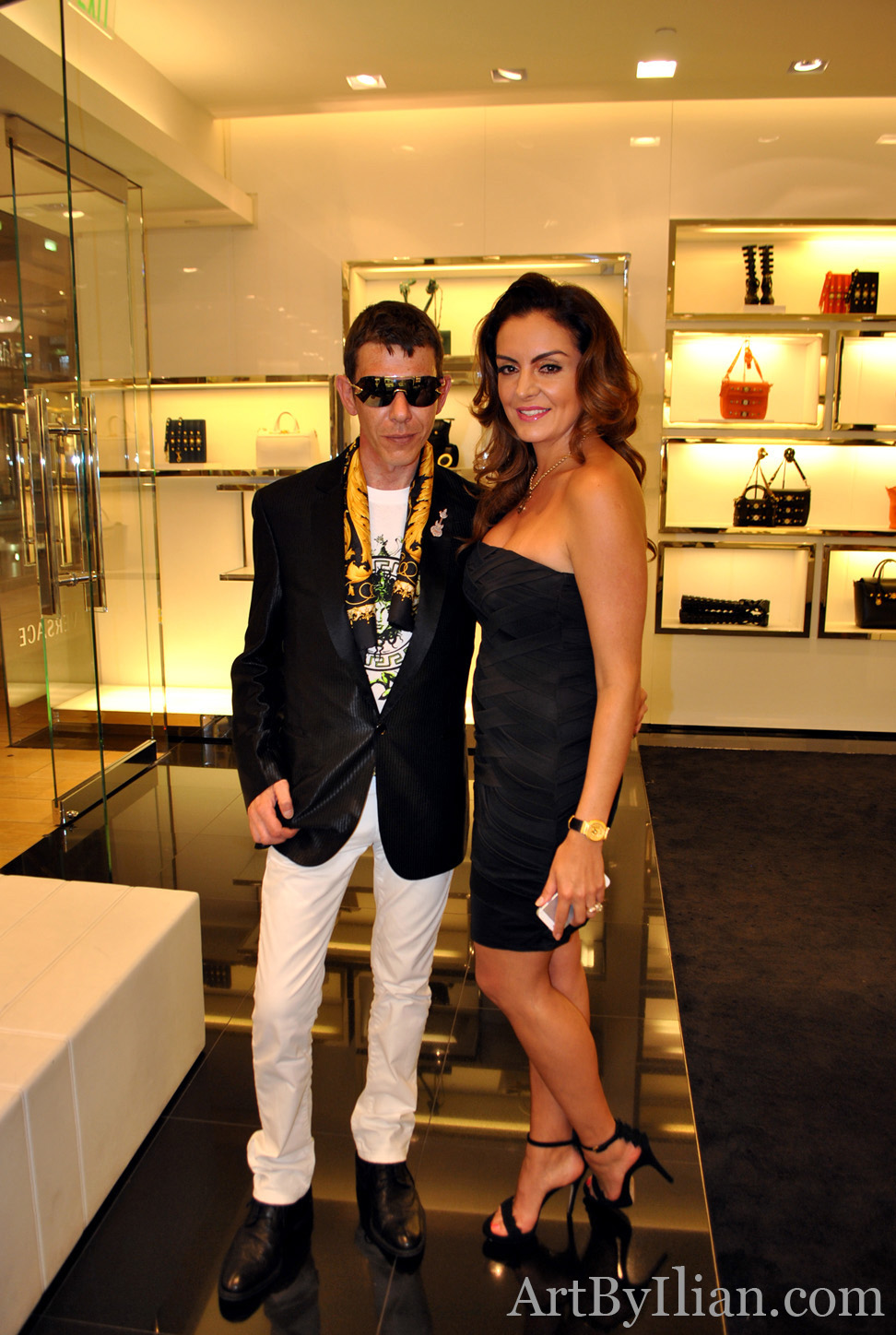 Ilian Rachov and the Tv presenter Carmina Zamorano at Versace Soiree in Houston 2013.